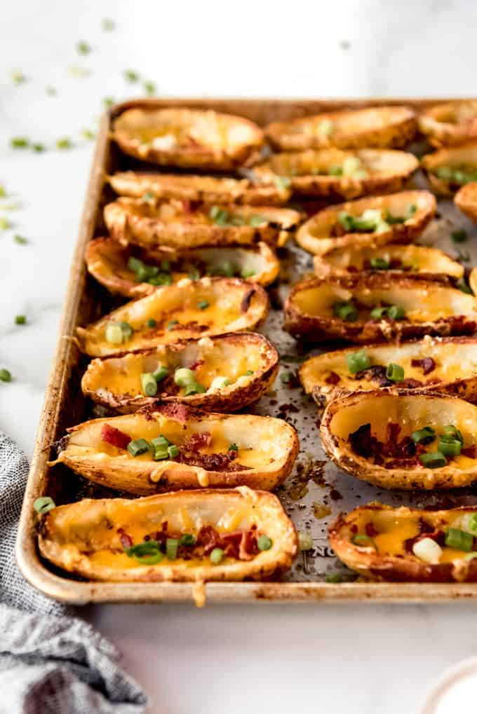 An image of loaded potato skins on a baking sheet.