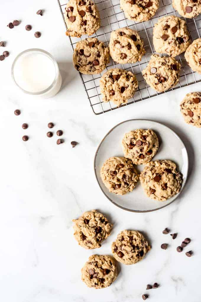 An image of homemade easy oatmeal cookies with a glass of milk.