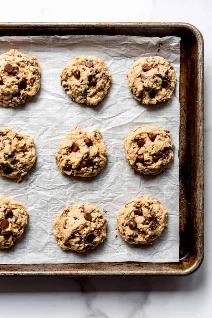 An image of a homemade oatmeal chocolate chip cookies on a baking sheet.