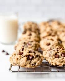 An image of oatmeal chocolate chip cookies on a wire cooling rack.