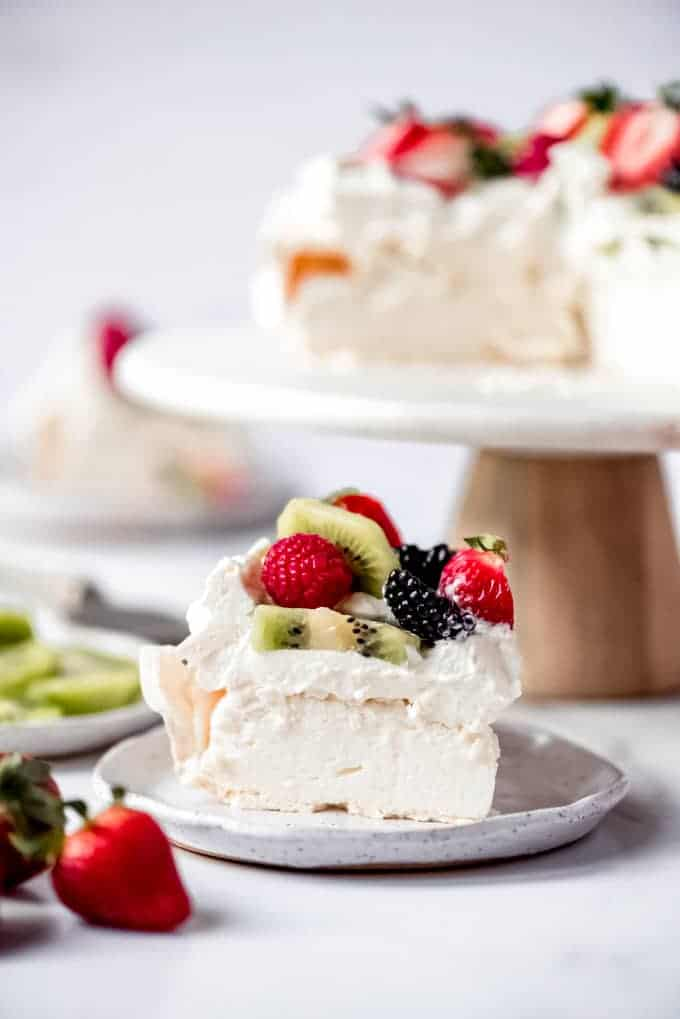 An image of a slice of light and fluffy homemade pavlova cake.