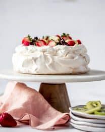 An image of a classic pavlova on a cake stand.
