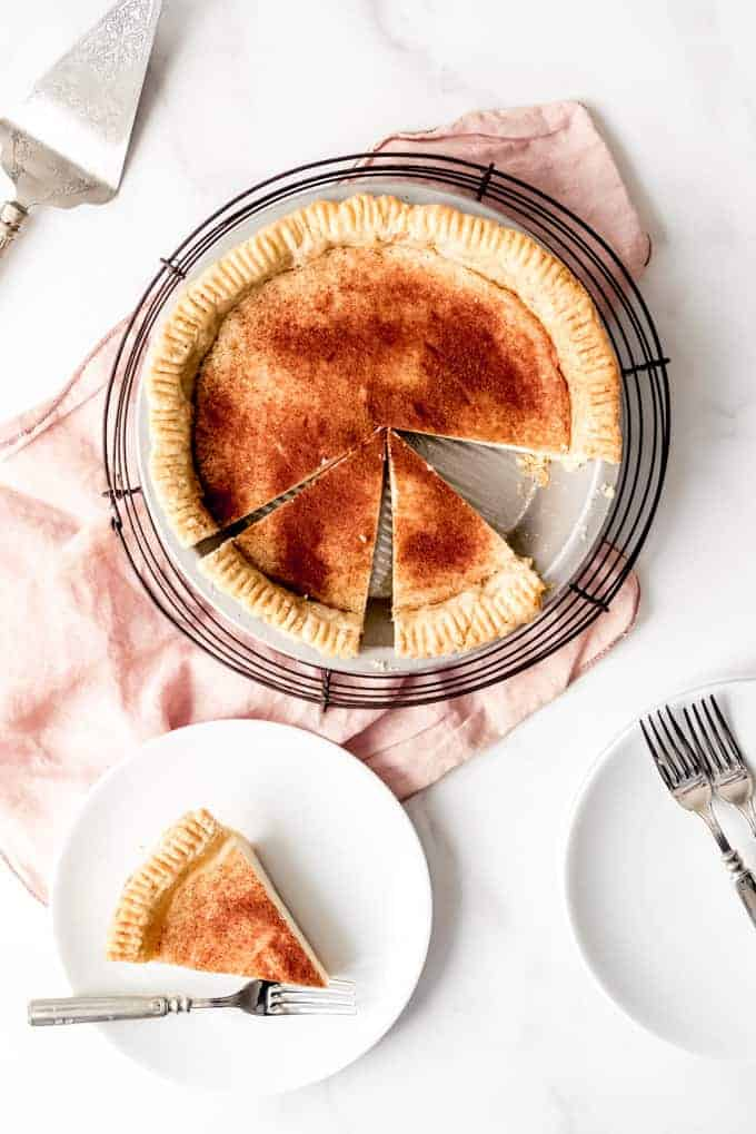 An image of a homemade cream pie with cinnamon and nutmeg on top.