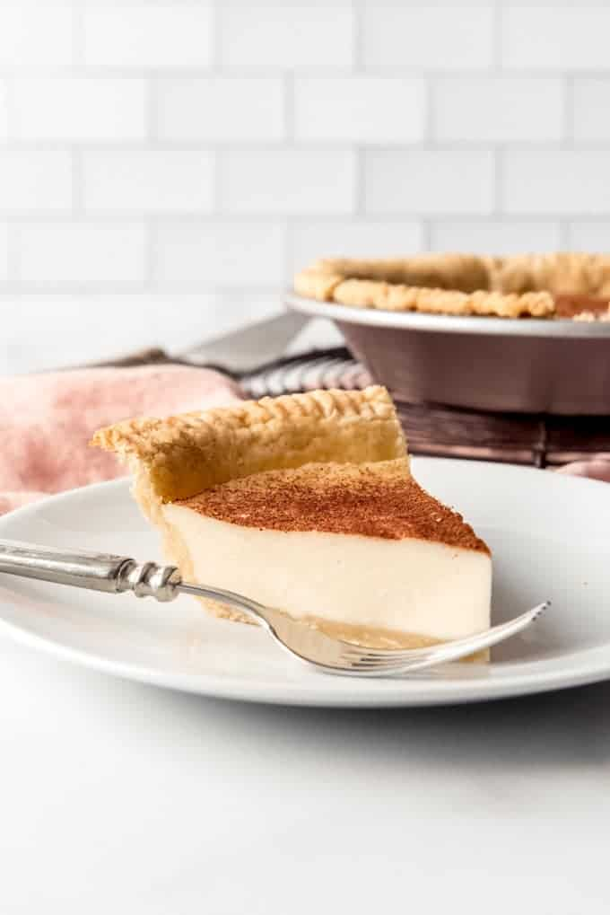 An image of a slice of an easy custard pie made without eggs.