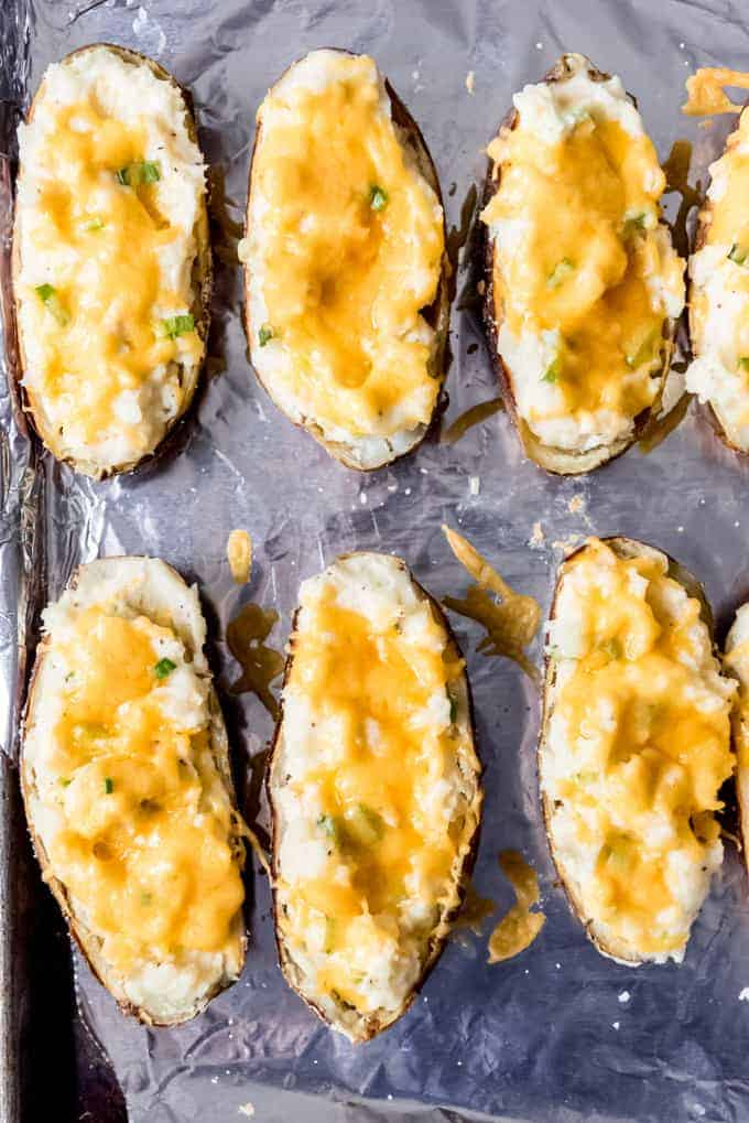 An image of loaded mashed potatoes in potato skins.