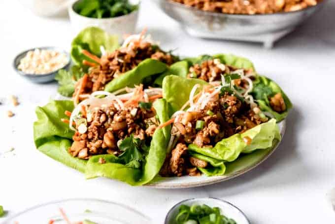 An image of lettuce wraps made with ground chicken on a plate.