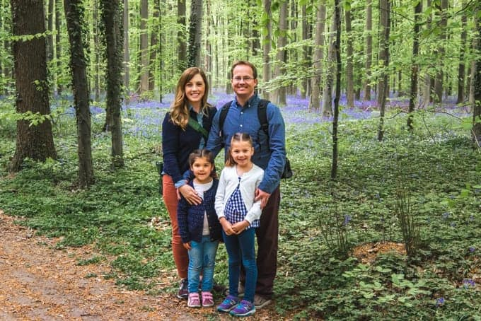 An image of a young family in a forest in Belgium.