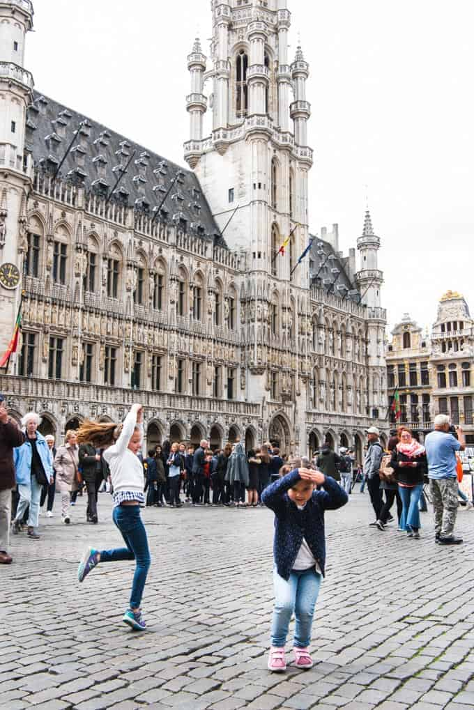 An image of kids dancing in the Grand Place in Brussels.