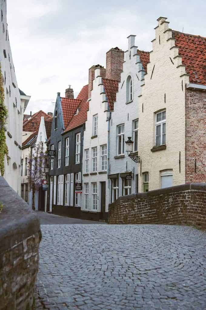 An image of an empty cobblestone street in Bruges, Belgium.