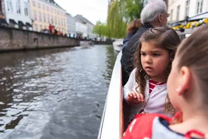 An image of a child looking at the water from a boat.
