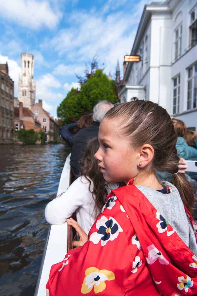 An image of a child on a boat ride along the canals in Bruges.