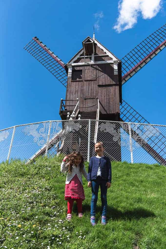 An image of children standing in front of a windmill.