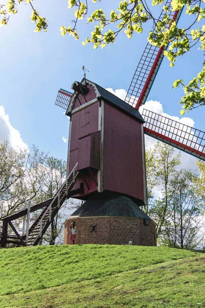 An image of a historic windmill in Bruges, Belgium.