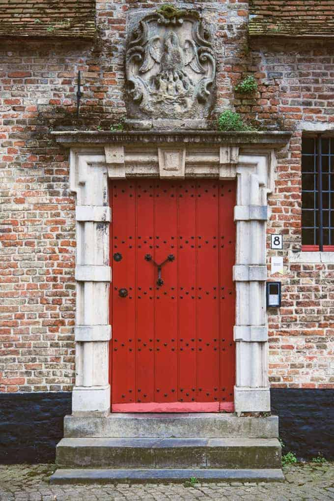 An image of a red door in Bruges, Belgium.