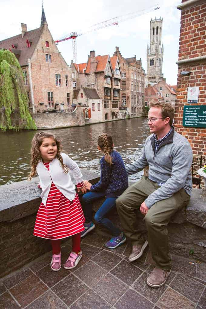 An image of a dad and children at the Quay of the Rosary in Bruges, Belgium.