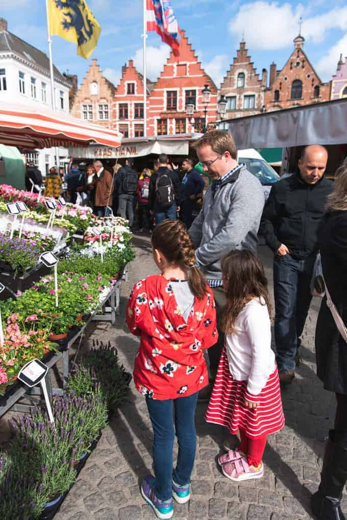 An image of a family at a market in Bruges.