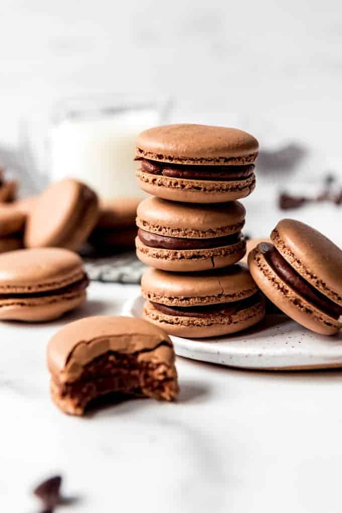 An image of homemade chocolate macaron shells with feet on them.