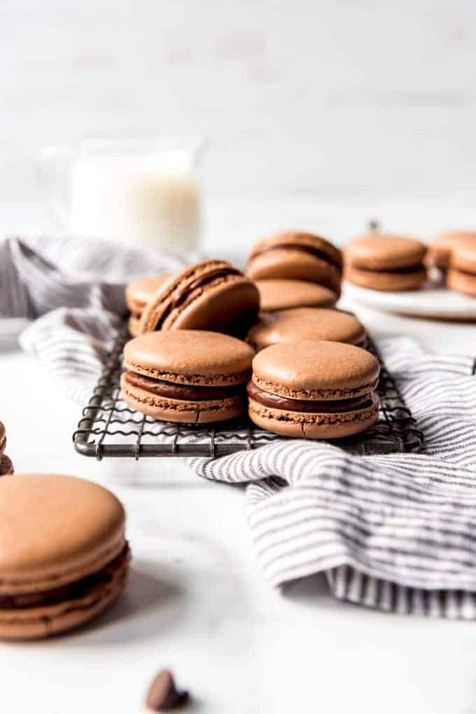 An image of french chocolate macarons on a wire rack.
