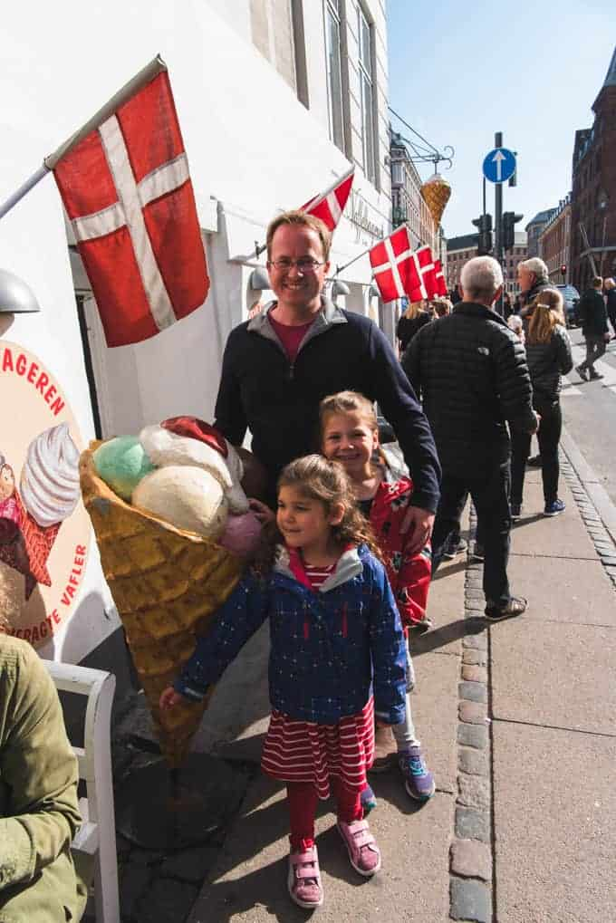 A dad and two kids outside an ice cream shop in Copenhagen.