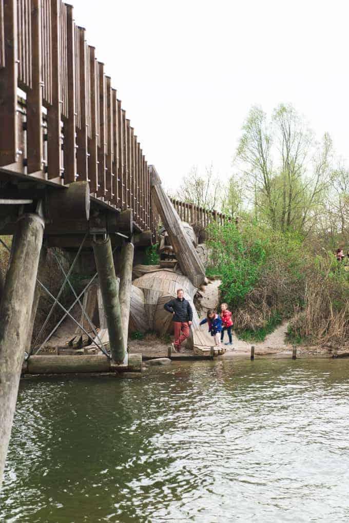 A giant under a bridge.