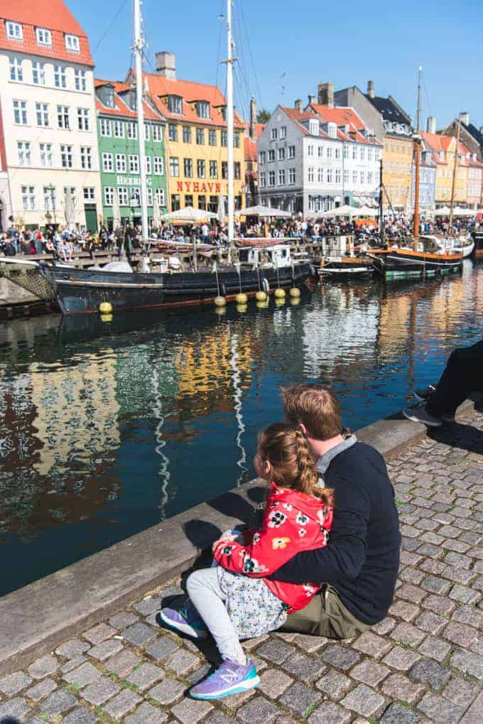 A family by the water in Nyhavn in Denmark.