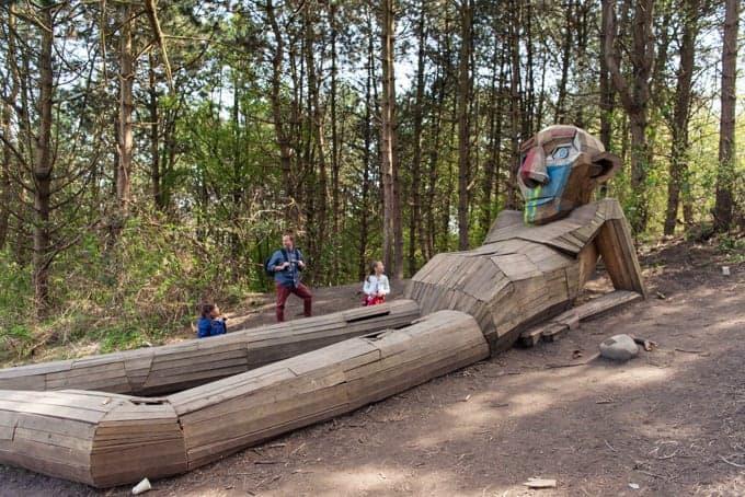 A reclining giant sculpture.