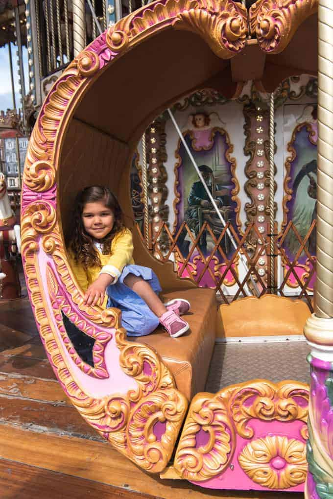 An image of a child on a carousel in Honfleur, France.