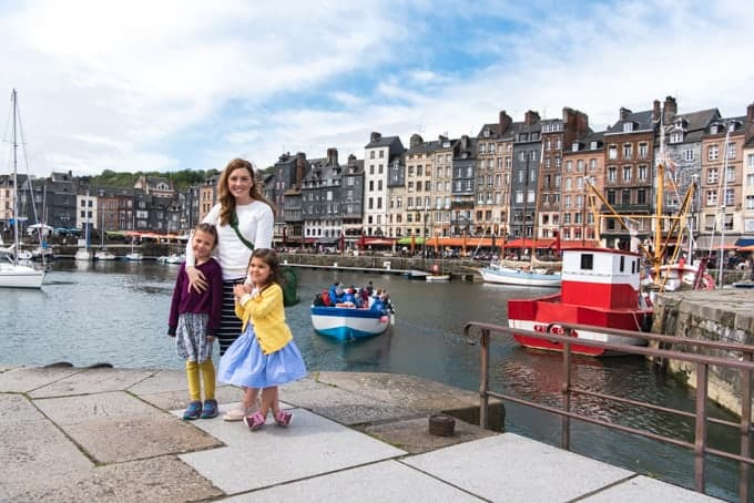 An image of a mother and daughters in front of the Vieux Bassin in Honfleur, France.