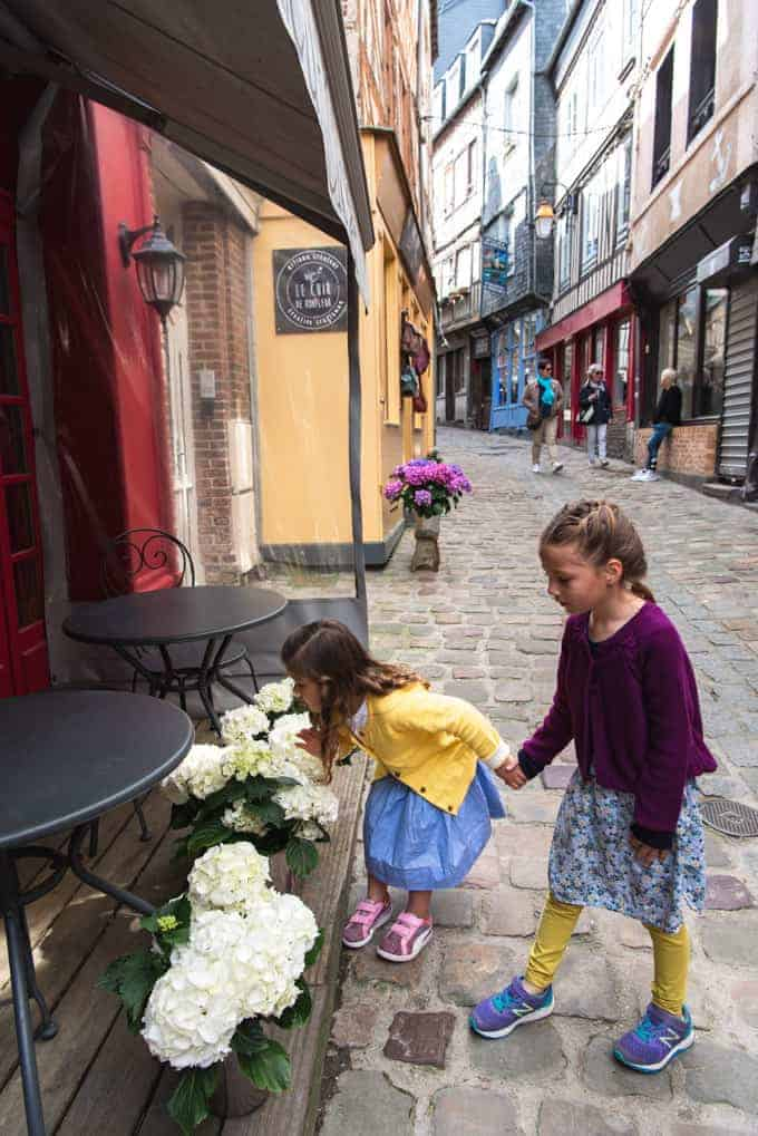An image of children exploring the cobblestone streets of Honfleur, France.