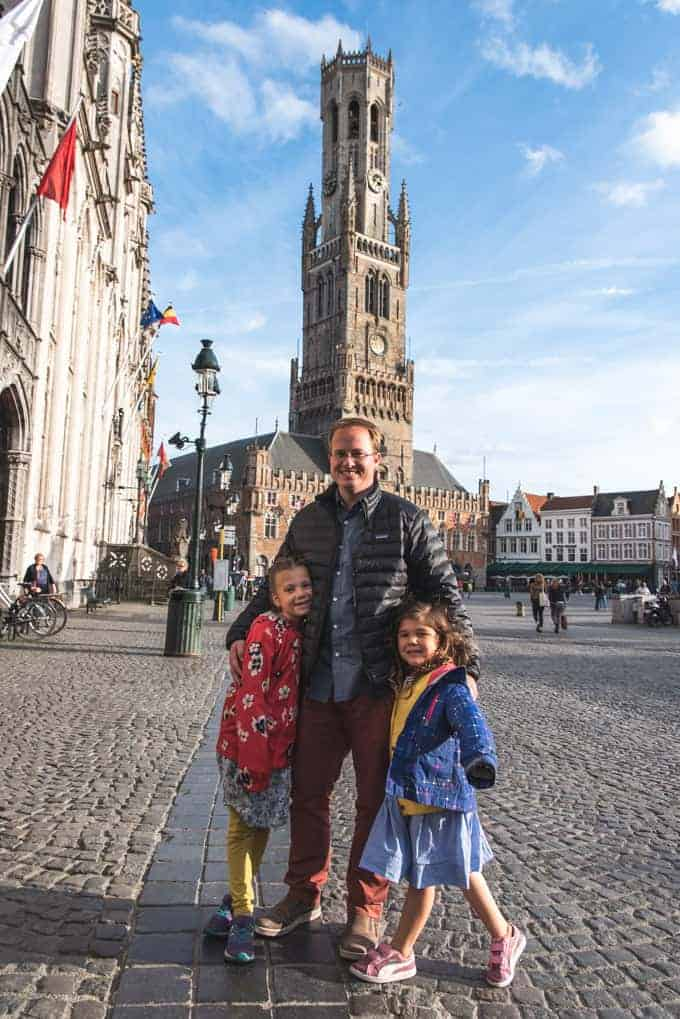 A dad and two daughters in Bruges, Belgium.