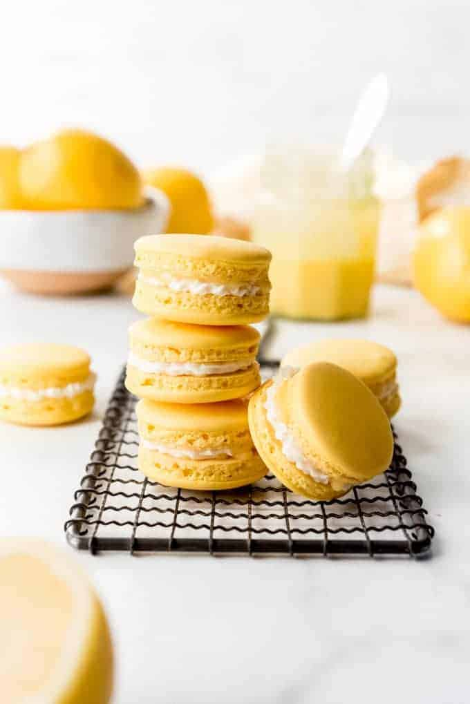 An image of lemon macarons stacked on top of each other.