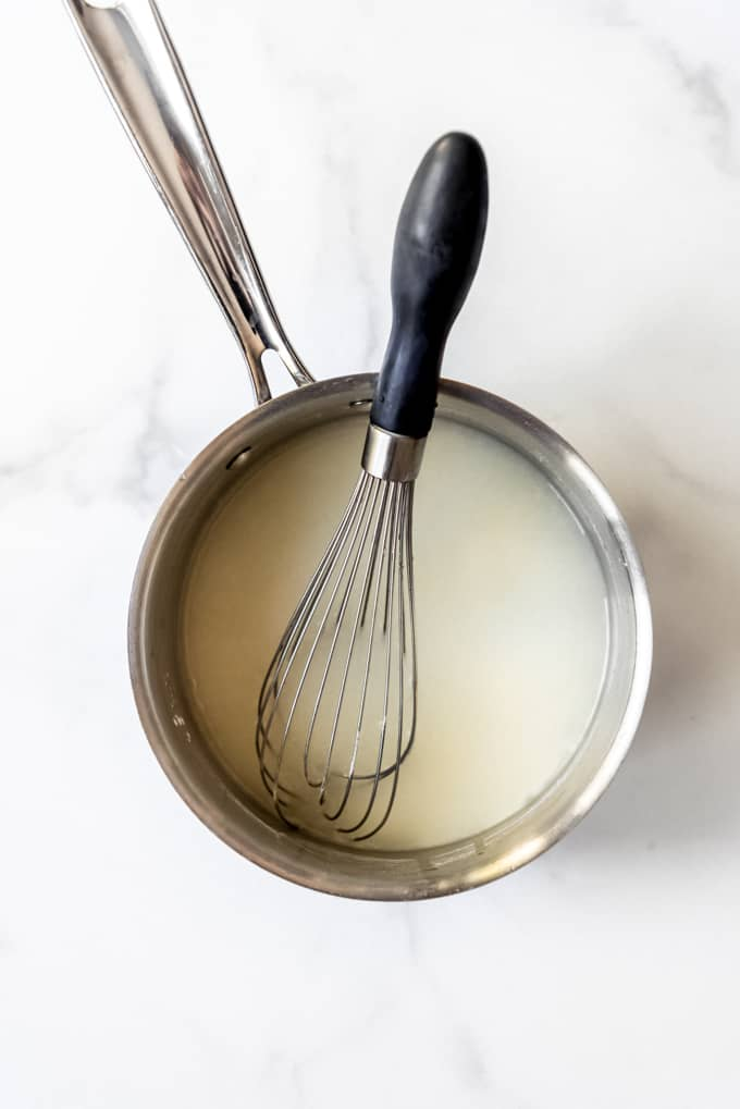 Sugar mixture in a saucepan with a whisk