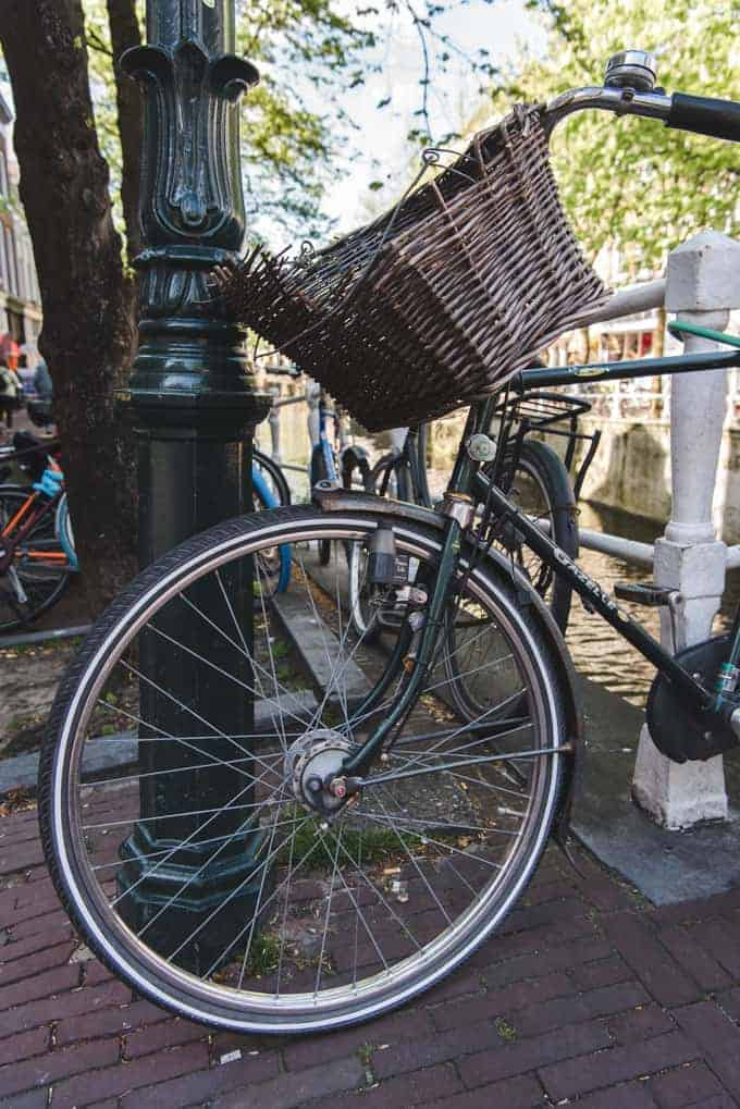 An image of a bike with a woven basket.