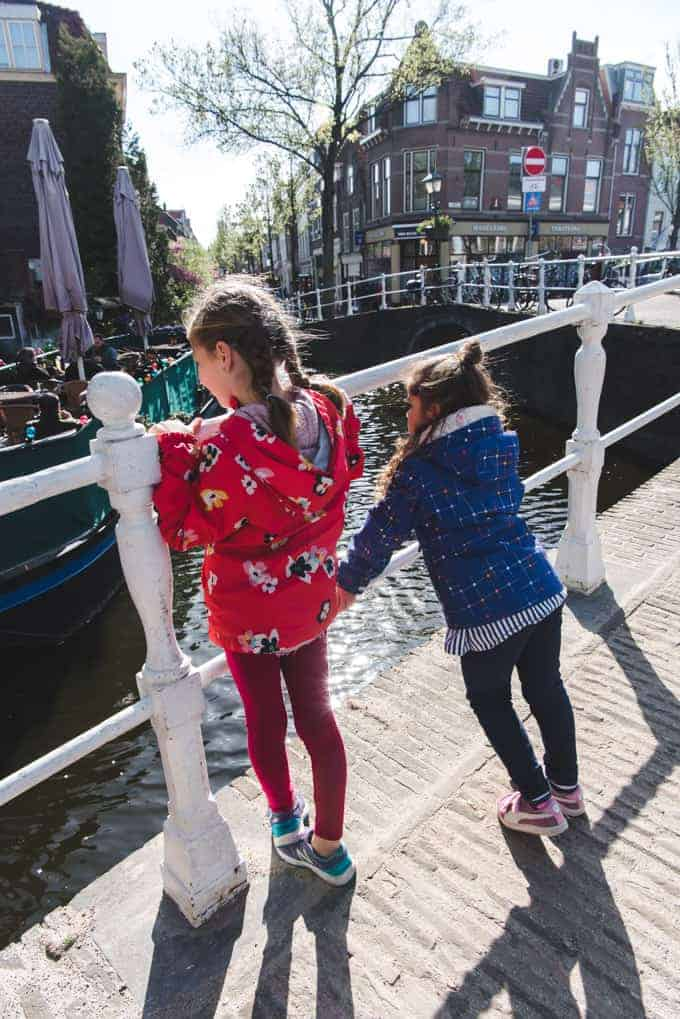 An image of two children looking at canals in Delft, the Netherlands.
