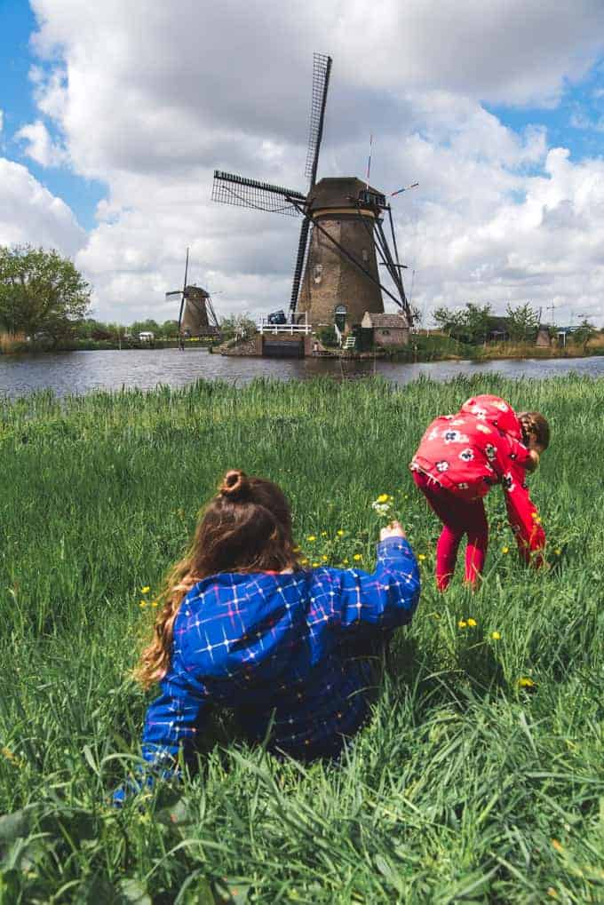 An image of children playing in front of a windmill.