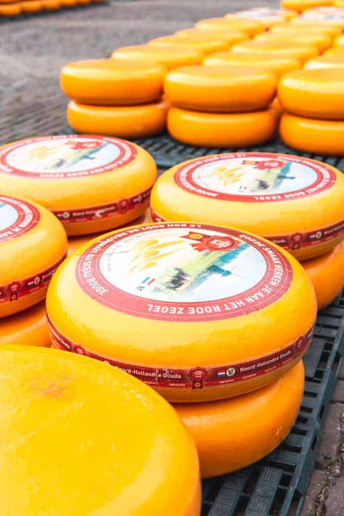 An image of stacks of cheese wheels in the Netherlands.
