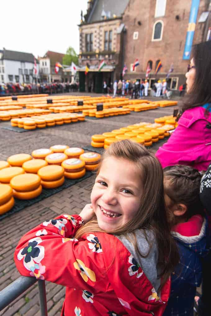 An image of a child at a cheese market in the Netherlands.