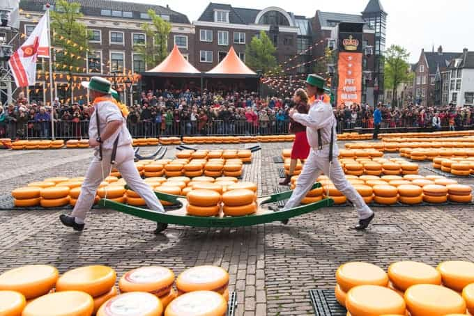 An image of members of the Cheese Carriers' Guild carrying cheeses at a market in Alkmaar, the Netherlands.