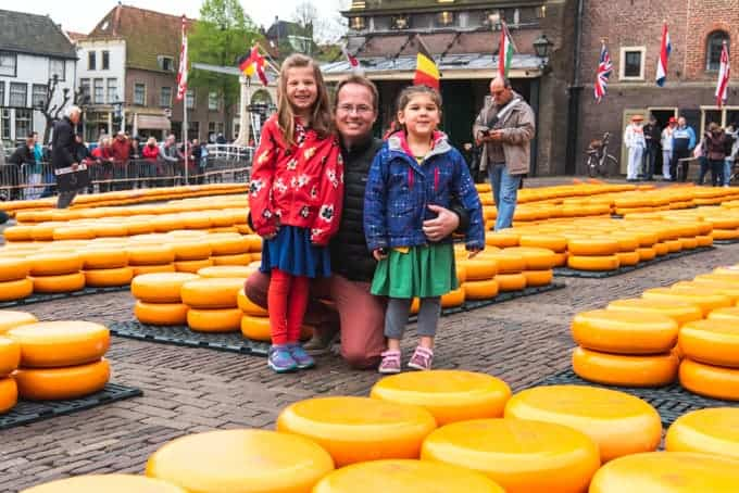 An image of a father with two daughters at the Alkmaar Cheese Market in the Netherlands.