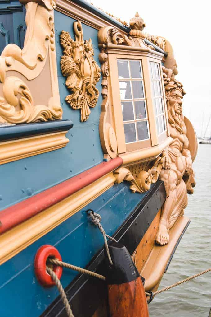An image of an ornate cabin window on an old ship in Volendam, Netherlands.