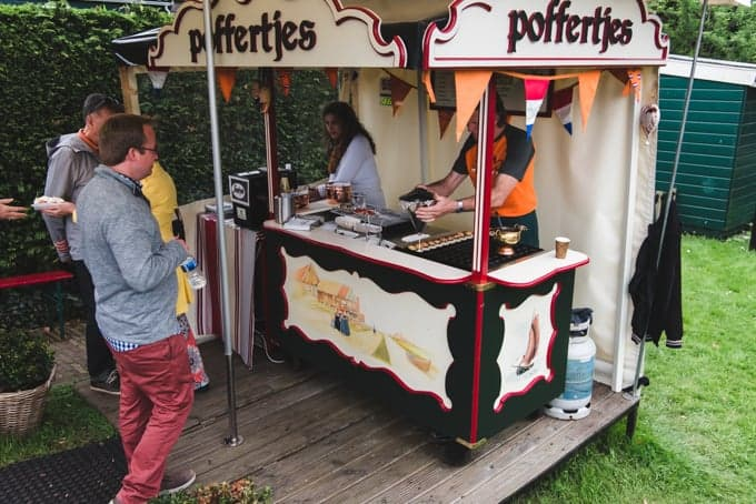 An image of a street vendor making poffertjes in the Netherlands.