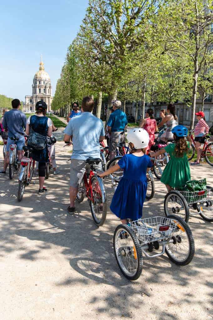 An image of a group of bike riders with kids on a Fat Tire Tour in Paris.