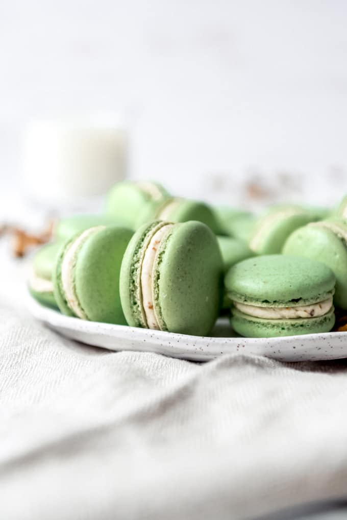 An image of French cookies made with almond flour and pistachios on a plate.
