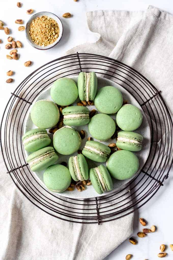 An image of homemade pistachio macarons arranged on a plate.