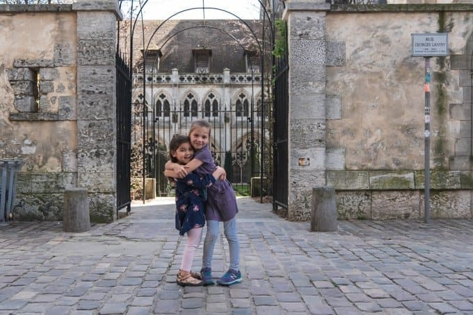 An image of kids hugging in Rouen, France.
