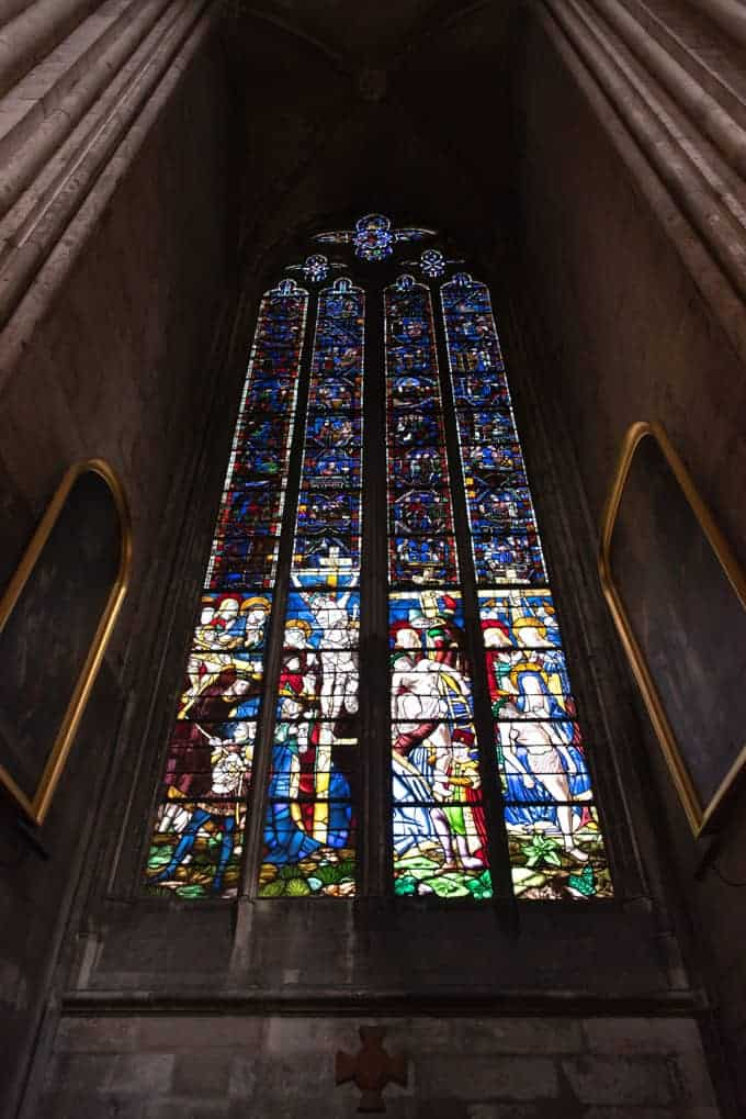 An image of a stained glass window in a cathedral in Rouen, France.