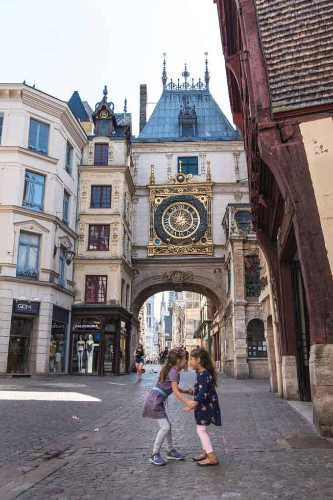 An image of two girls in front of the clock tower in Rouen, France.
