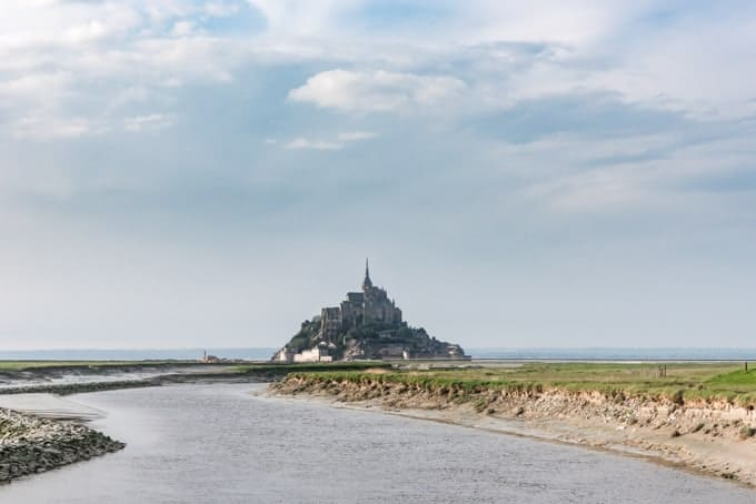 An image of Mont Saint-Michel with water in front of it.
