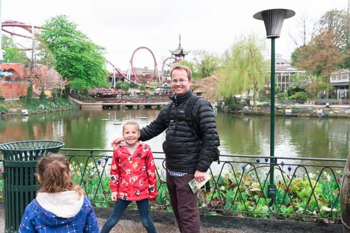 A dad and kids in Tivoli Gardens.