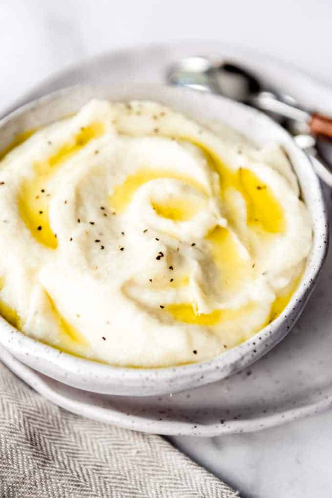 olive oil drizzled over swirls of mashed cauliflower in a bowl
